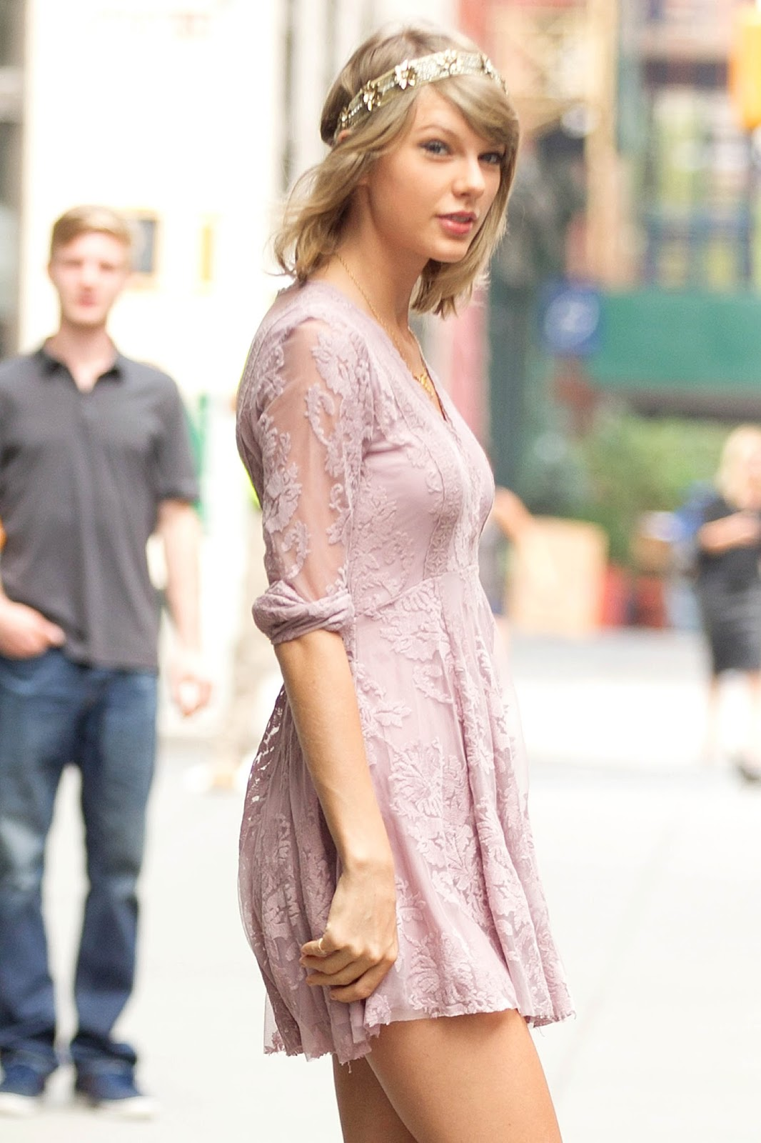 Taylor Swift shows long legs in a Free People dress in NY