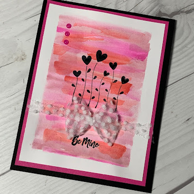 Watercolor wash background on a Valentine Card