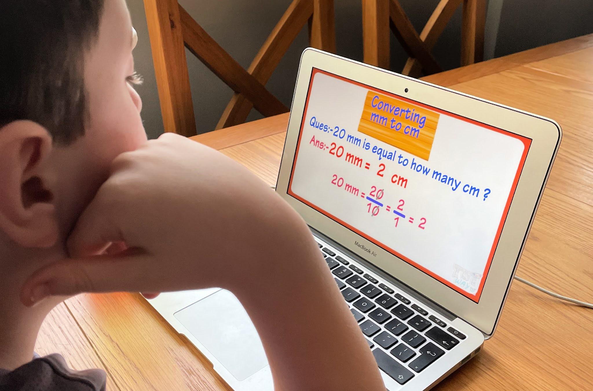 boy looking at a computer screen