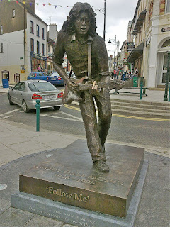 A bronze statue of Gallagher in Ballyshannon, County Donegal
