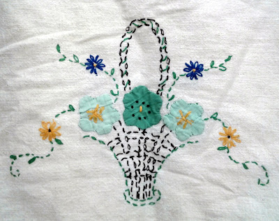 embroidered and appliqued tea towel with a basket and flowers