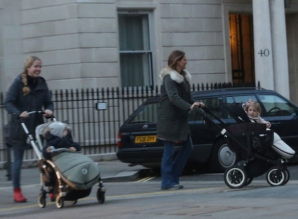 Princess Madeleine was seen in downtown of London while she was showing her children Princess Leonore and Prince Nicolas, Princess Madeleine wore coat, style