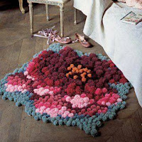 Alfombras DIY con pompons para el hogar