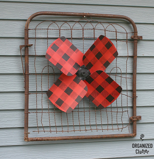Garage Sale Fan Blade Re-purposed As A Wall Flower #upcycle #repurpose #junkgarden #garagesalefinds #buffalochecks #oldsignstencils #stencil #outdoordecor