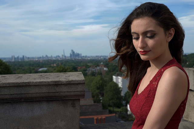 portrait on the roof, city in the background