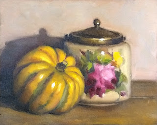 Still life oil painting of a yellow pumpkin beside an Art Deco biscuit barrel.