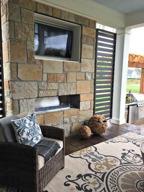 outdoor fireplace and TV combo