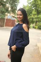 Poojita Super Cute Smile in Blue Top black Trousers at Darsakudu press meet ~ Celebrities Galleries 065.JPG