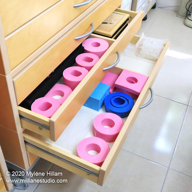 Flat drawers filled with pink and blue resin bangle moulds