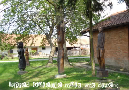 The lightness of art or Podravina blues by Laka kuharica: wooden sculpture in front of the Gallery