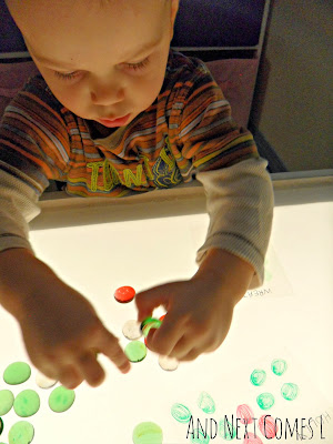 K making Christmas objects on the light table from And Next Comes L