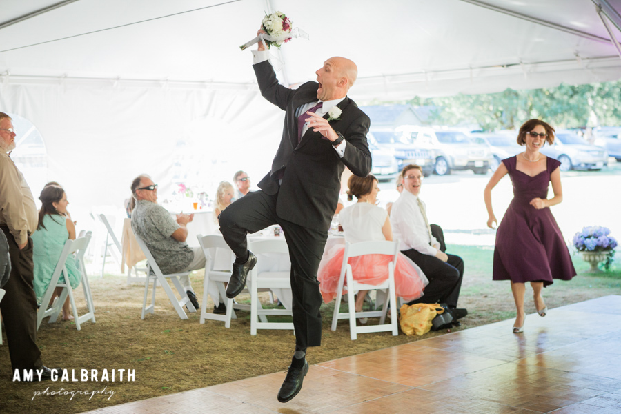groomsman catching wedding bouquet