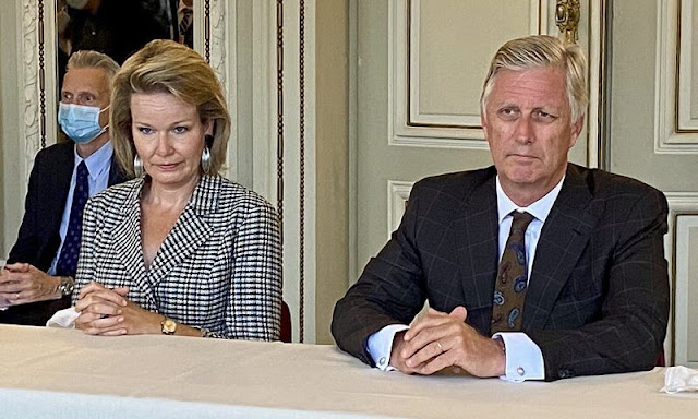 Queen Mathilde wore a tweed jacket from Natan, and The Queen wore grey checked plaid trousers from Natan