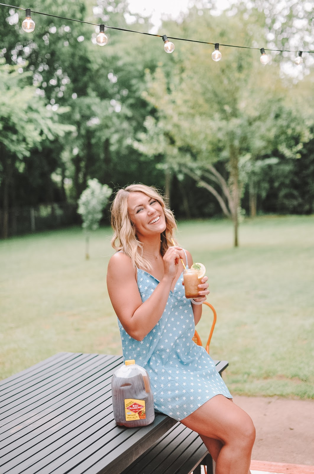 blogger Amanda Martin of OKC blog Amanda's OK enjoying an Okie Sweet Tea Slush cocktail made with Red Diamond Iced Tea