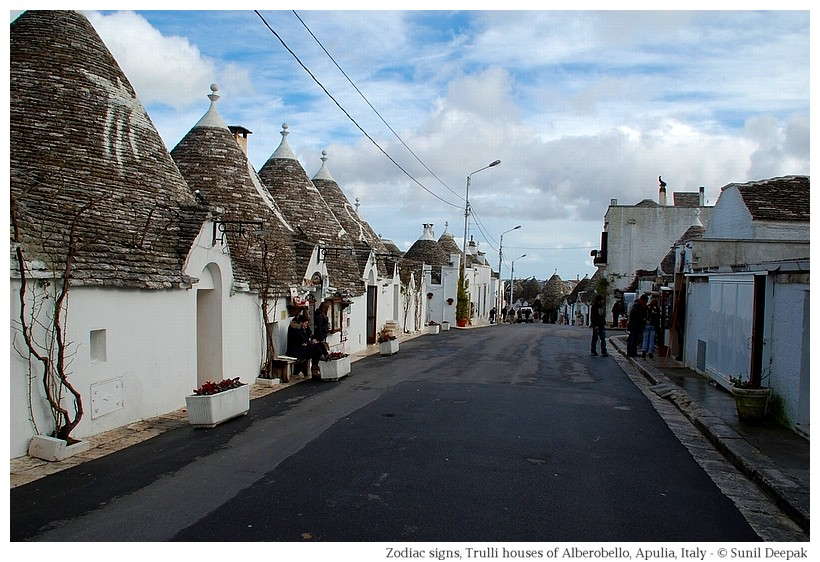 Trulli houses in Alberobello with zodiac signs painted on the roof - Photographs by Sunil Deepak