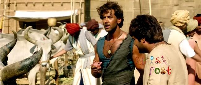 Hrithik Roshan as villager Sarman looking surprisingly at Pooja Hegde in Mohenjo Daro