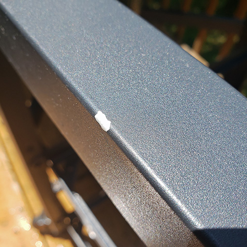 Example of powder coating chip on a Big Green Egg Modular Nest