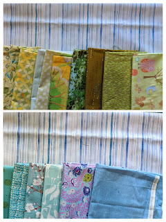 Collections of green and blue prints against the blue and white striped background fabric