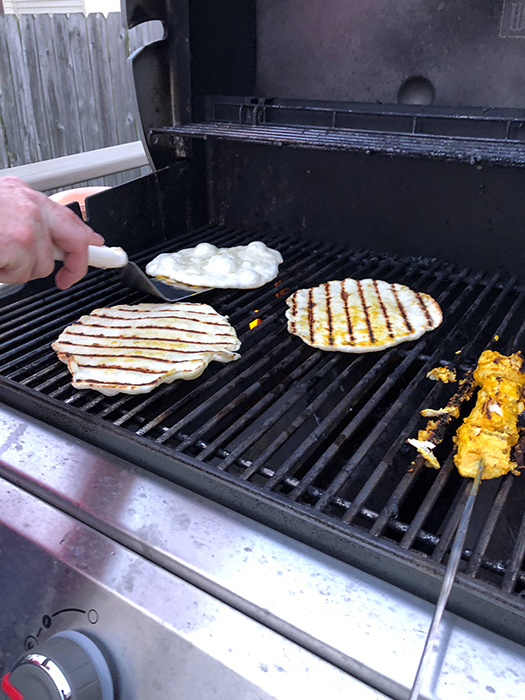 flipping flatbreads on hot grill