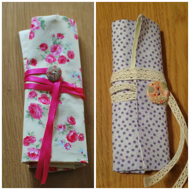 two finished crochet hook rolls