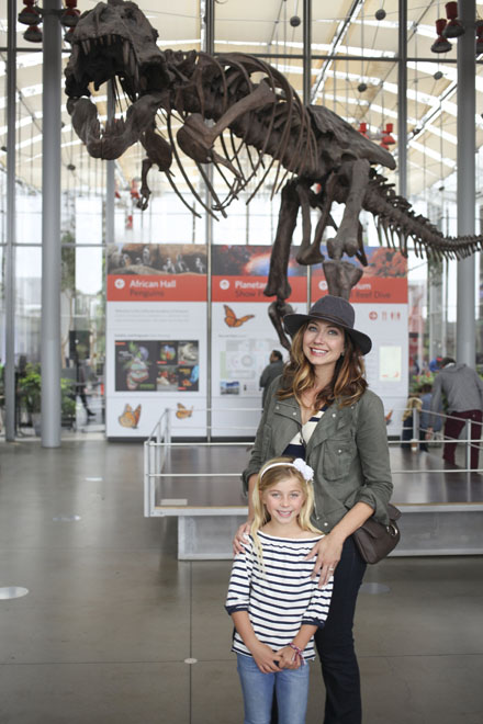 Amy West and daughter stand at the entrance of the California Academy of Sciences