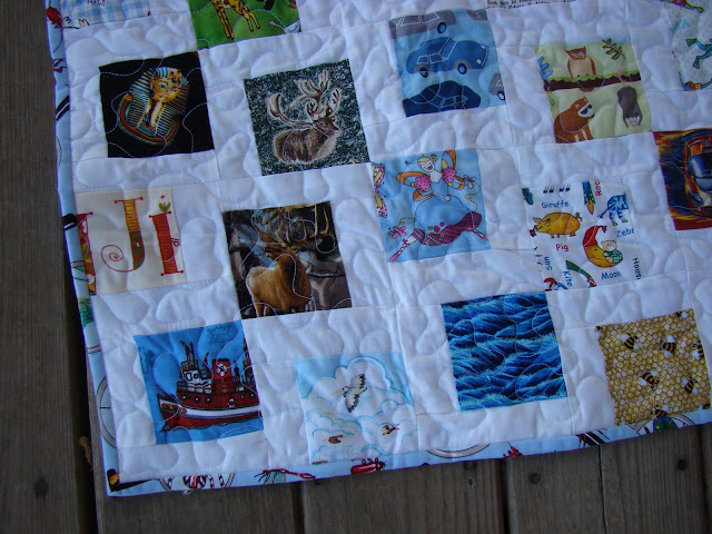 Disappearing nine patch I Spy quilt