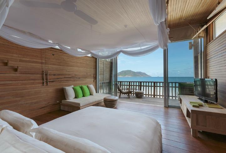 Coastal island style bedroom with ocean view