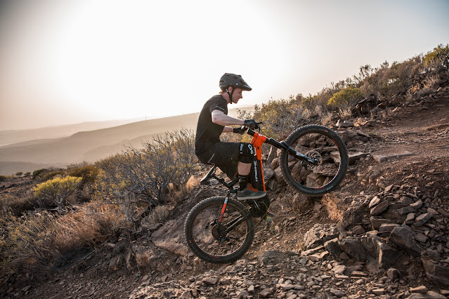 Tom Cardy climbs a steep rough trail on his Haibike ALLMTN 2.0 e-bike.