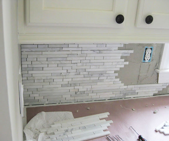 white kitchen makeover with marble backsplash