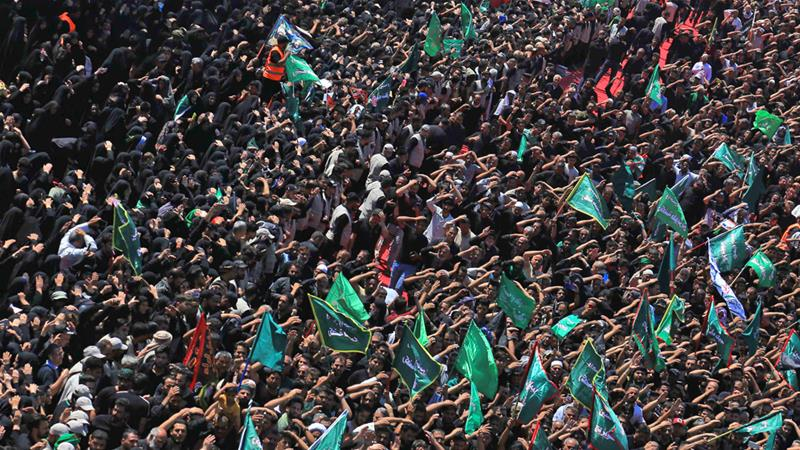 Hundreds of thousands of Shia take part in a mourning procession in the holy city of Karbala on Tuesday