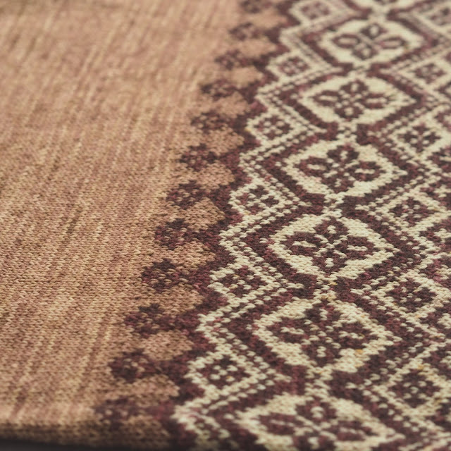 close up of colourwork section in cream and burgundy