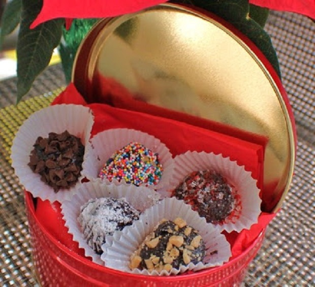 these are a no bake truffle cookie in a red tin rolled into sprinkles and nuts