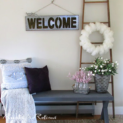 Winter decor in the entry using soft pretty muted colors and texture.