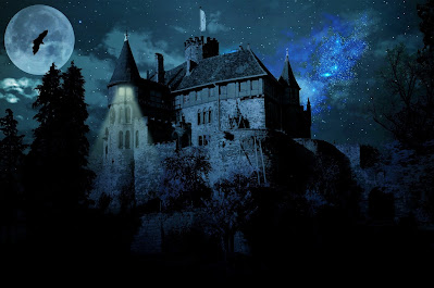 Haunted castle under the cover of a full moon