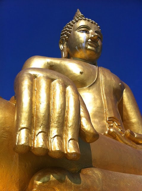 A huge golden Buddha in Santisuk, Nan - Thailand