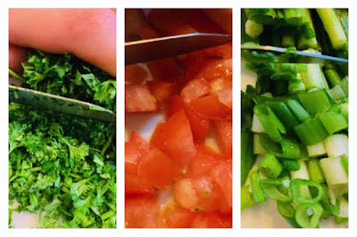 Chopping parsel, tomatoes and green onions for tabbouleh recipe.