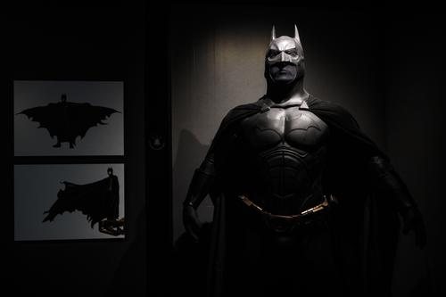 A Batman costume from the 2005 Batman Begins film worn by Christian Bale and designed by Lindy Hemming is on display at the DC Comics Exhibition: Dawn Of Super Heroes at the O2 Arena on February 22, 2018 in London, England