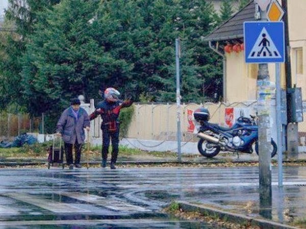 When this man got off of his motorcycle to halt traffic, so an elderly man could cross the street.