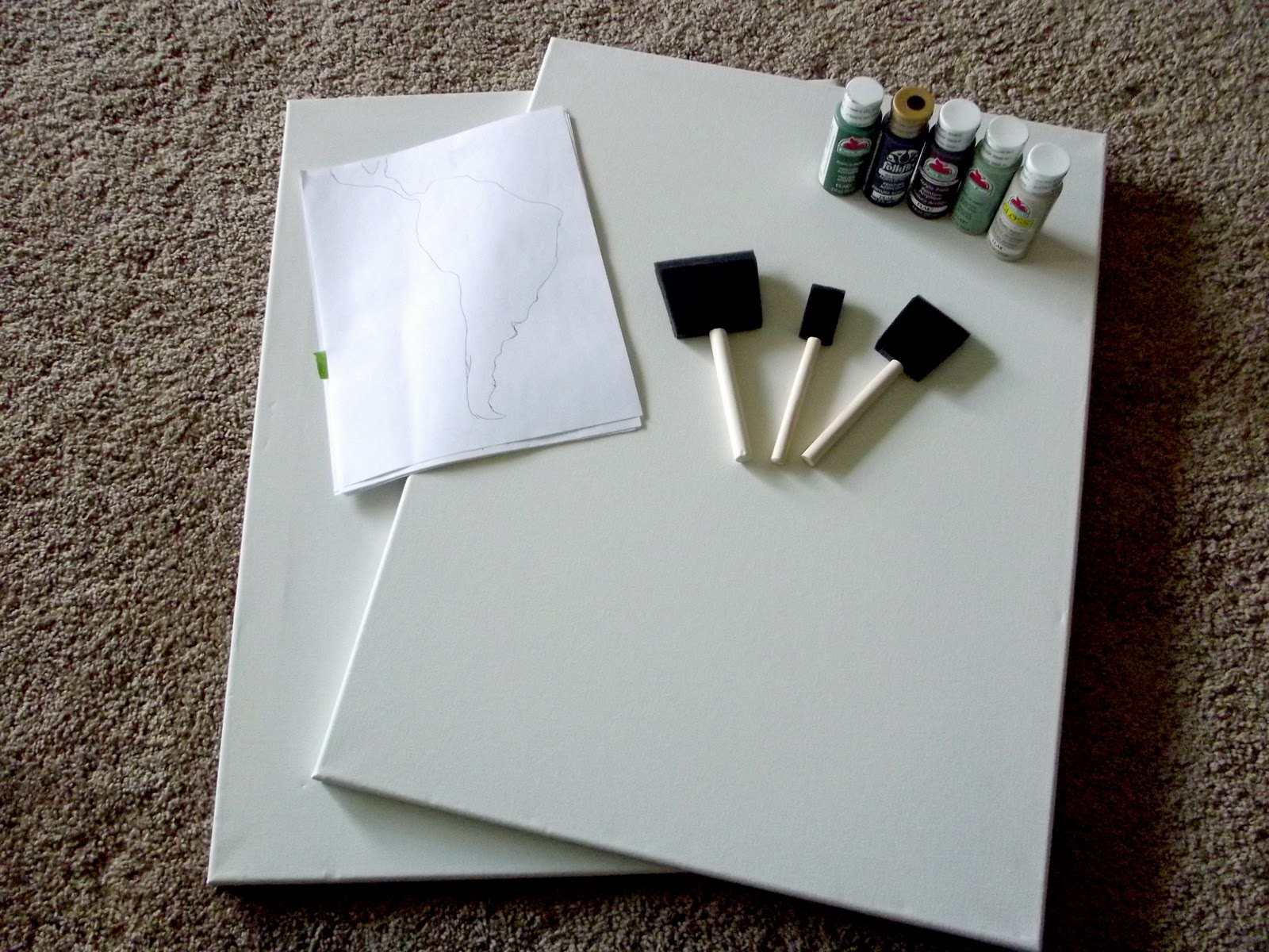 First step what youll need is a couple of canvases i got mine with a 50 off coupon at michaels so it was about 10 for two a design template paint