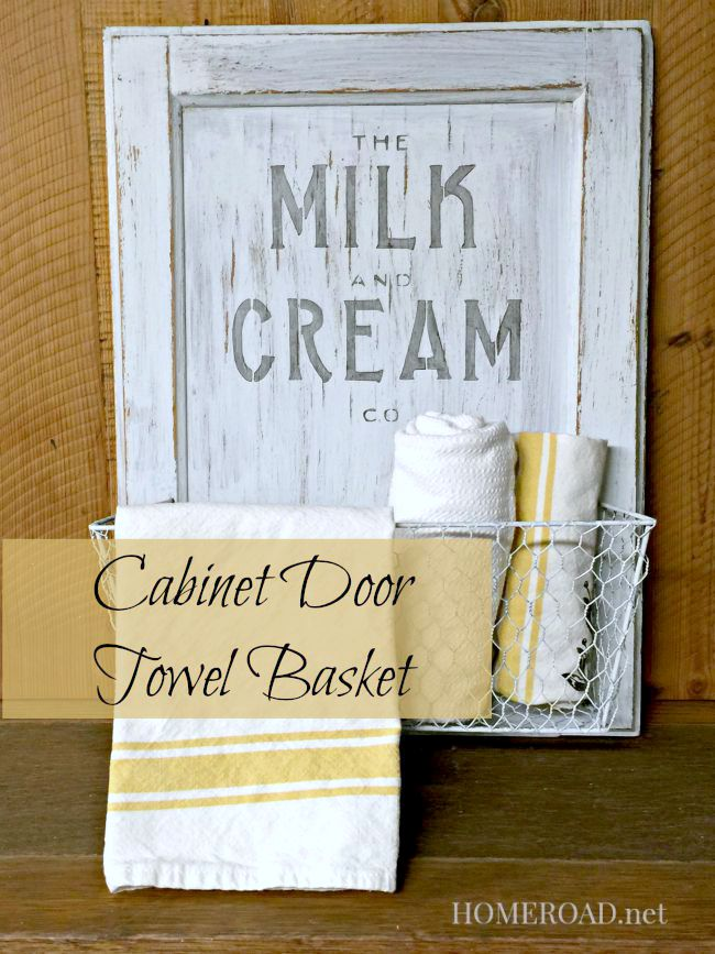 Distressed cabinet door basket with tea towels