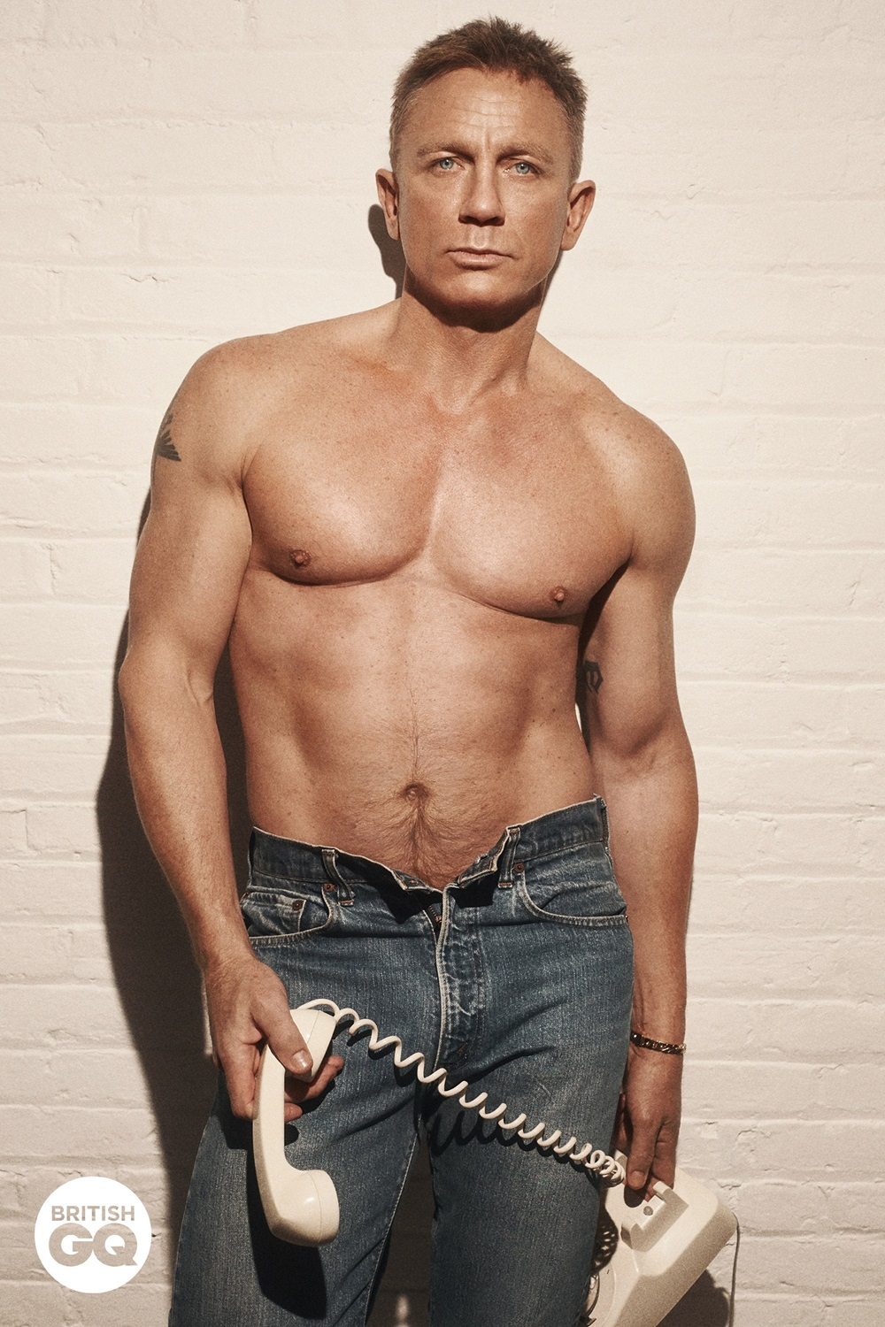 Daniel Craig is a hunk as he poses shirtless for GQ Magazine