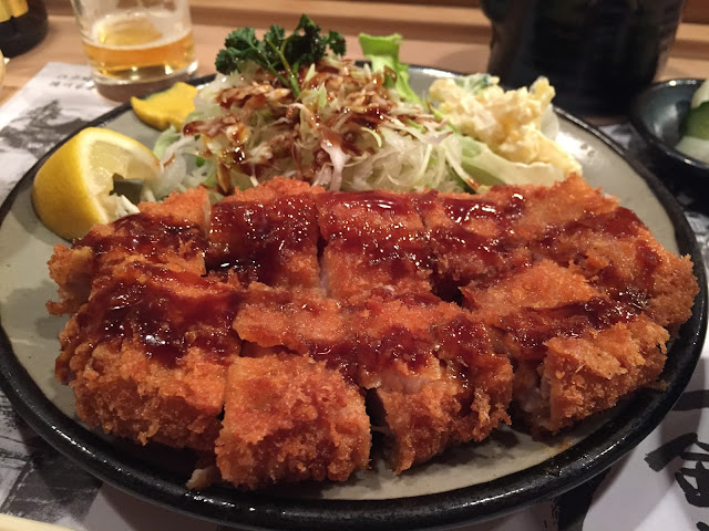 a photo of the best tonkatsu in Tokyo covered in a tangy bbq sauce