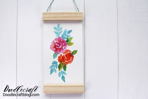 Recycle old Jenga wood pieces to make a hanging scroll from recycled materials.
