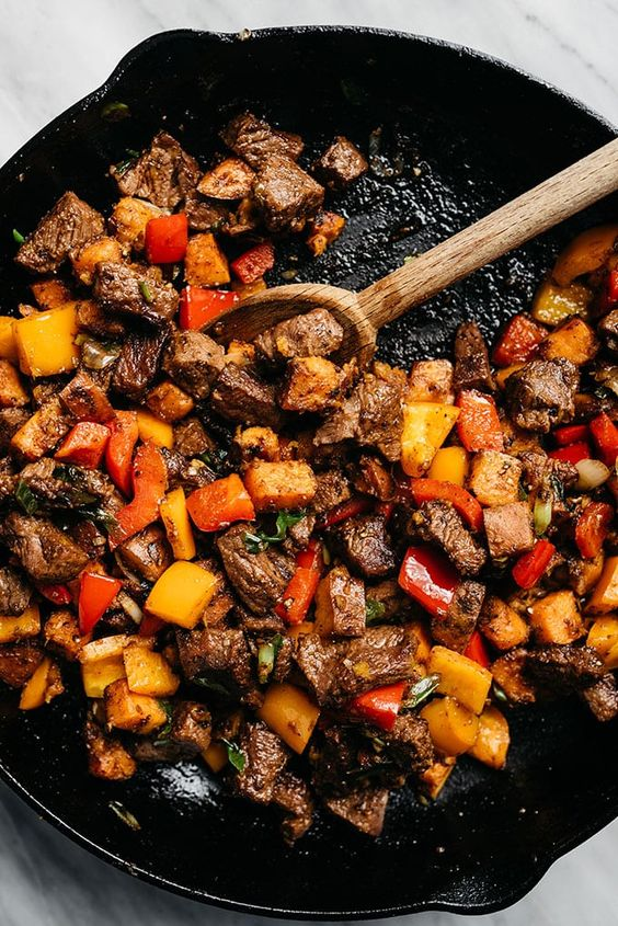 This recipe for Whole30 steak bites is packed with tons of flavor and huge pops of vitamins thanks to colorful sweet potatoes and bell peppers. It's an easy, approachable weeknight dinner recipe that's ready in under 45 minutes.