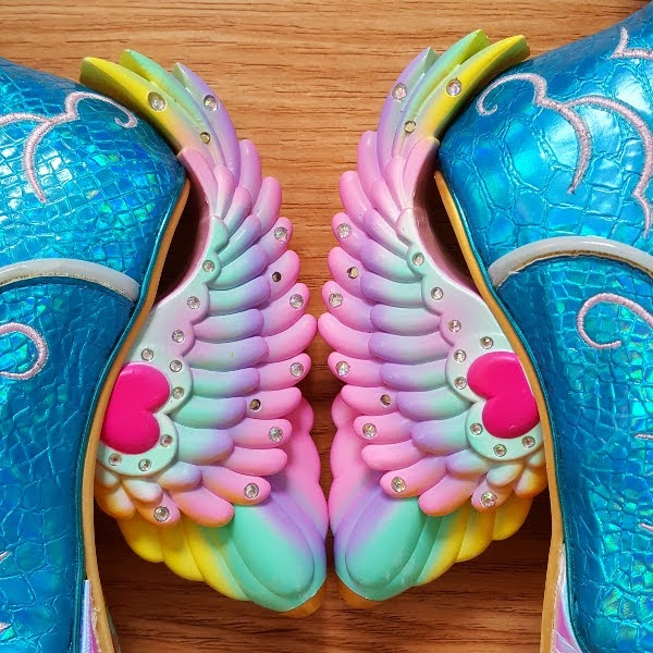 close up of rainbow angel wings heels on shoes