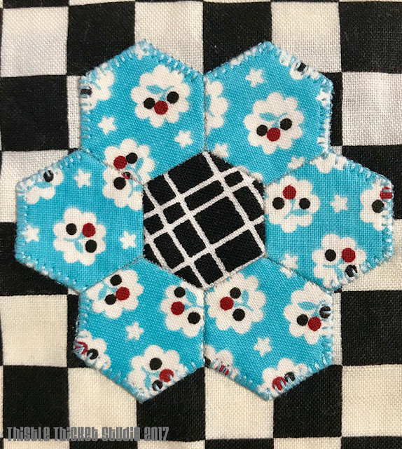 English Paper Pieced Hexie Flower by Thistle Thicket Studio. www.thistlethicketstudio.com