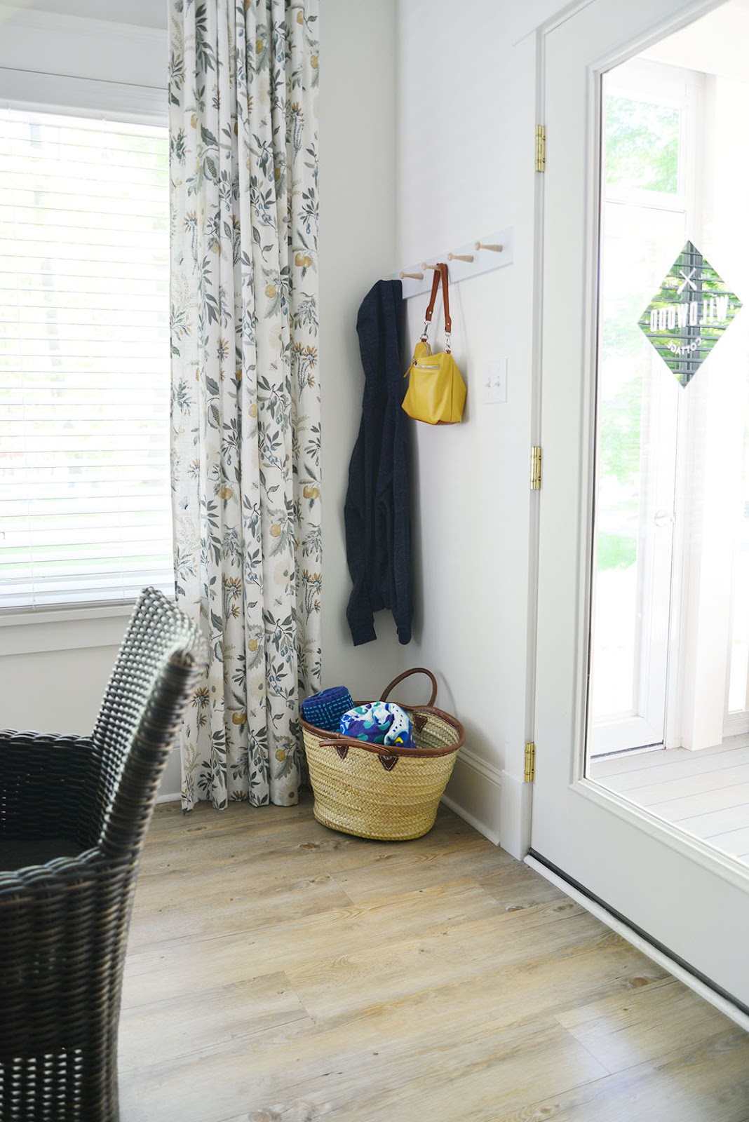 diy shaker peg rail, woven market tote basket with towels, fleur botanical la mer fabric, glass door with decal