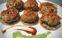 Serving garnished mutton Lamb galouti kebab with roti