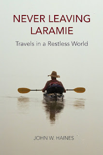 cover of Never Leaving Laramie: Travels in a Restless World by John W. Haines