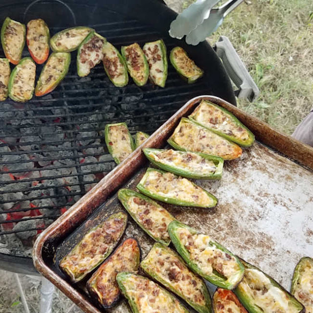 taking stuffed jalapenos off grill